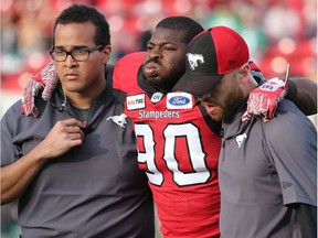 Calgary Stampeders defensive lineman Folarin Orimolade is helped off the field after being injured during pre-season CFL action against the Saskatchwan Roughriders at McMahon Stadium in Calgary on Friday May 31, 2019. Gavin Young/Postmedia