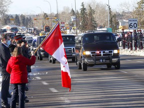 Hundreds of police and their families along with citizens lined the street at Memorial Drive and 68 Street to honour Sgt. Andrew Harnett during his funeral procession in Calgary on Tuesday, January 5, 2021. Darren Makowichuk/Postmedia