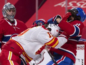 MONTREAL, QC - JANUARY 28:  Ben Chiarot #8 of the Montreal Canadiens and Matthew Tkachuk #19 of the Calgary Flames play rough during the third period at the Bell Centre on January 28, 2021 in Montreal, Canada.  The Montreal Canadiens defeated the Calgary Flames 4-2.