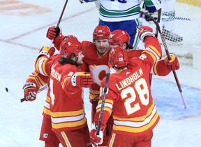 The Calgary Flames celebrate Sean Monahan's first period goal on the Vancouver Canucks during the Calgary Flames NHL home opener on Saturday, January 16, 2021.  Gavin Young/Postmedia