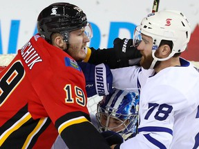 Calgary Flames Matthew Tkachuk battles against T.J. Brodie of theToronto Maple Leafs in front of Leafs goaltender Jack Campbell during NHL hockey in Calgary on Sunday January 24, 2021. Al Charest / Postmedia