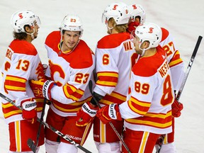 Calgary Flames Sean Monahan celebrates after gaol on goalie Jacob Markstrom during NHL hockey training camp intrasquad game at the Saddledome in Calgary on Thursday January 7, 2021.  Al Charest / Postmedia
