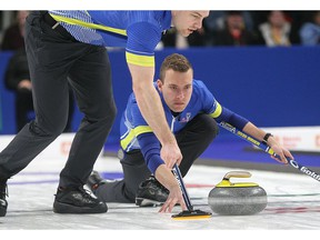 Alberta skip Brendan Bottcher throws a rock against against Newfoundland and Labrador as Brad Thiessen sweeps during the final of the 2020 Tim Hortons Brier in Kingston on Sunday March 8, 2020. Ian MacAlpine/Kingston Whig-Standard/ Postmedia Network