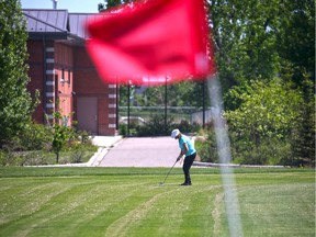 A golfer plays on the Richmond Green golf course.