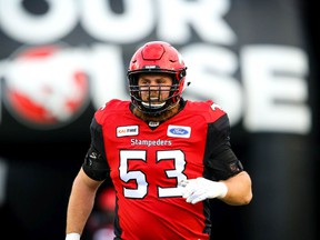 Brad Erdos of the Calgary Stampeders runs onto the field during player introductions before facing the BC Lions in CFL football on Saturday, October 13, 2018. Al Charest/Postmedia