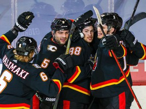 Feb 17, 2021; Calgary, Alberta, CAN; Calgary Flames left wing Andrew Mangiapane (88) celebrates his second period goal against the Vancouver Canucks with teammates at Scotiabank Saddledome. Mandatory Credit: Sergei Belski-USA TODAY Sports ORG XMIT: IMAGN-445168