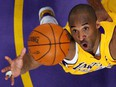 Los Angeles Lakers star Kobe Bryant jumps for a rebound against the Denver Nuggets during in Los Angeles May 21, 2009.