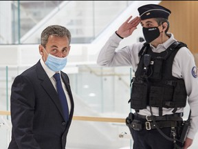 Former French president Nicolas Sarkozy leaves court after being found guilty of corruption and influence-peddling on March 1, 2021 in Paris.