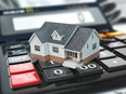 Mortgage calculator. House on buttons. Real estate concept. 3d. Getty Images/iStockphoto