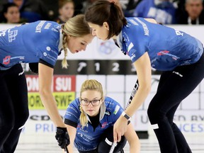 Fourth Alina Paetz, centre, delivers a rock for Silvana Tirinzoni's Switzerland team as lead Melanie Barbezat, left, and second Esther Neuenschwander sweep during the women's final at the Grand Slam of Curling's Princess Auto Elite 10 tournament at Thames Campus Arena in Chatham, Ont., on Sunday, Sept. 30, 2018. Mark Malone/Chatham Daily News/Postmedia Network