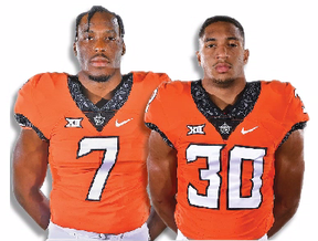 Linebacker Amen Ogbongbemiga (left) from Calgary, and Edmonton running back Chuba Hubbard -- teammates on the Oklahoma State Cowboys -- are both projected to be potential Day 3 picks in the NFL draft later this month.
