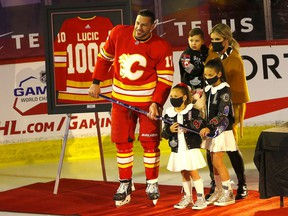 Calgary Flames winger Milan Lucic is honoured for his 1000th NHL game before taking on the Ottawa Senators at the Scotiabank Saddledome in Calgary on Monday, April 19, 2021.