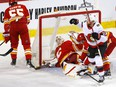 Calgary Flames goalie Jacob Markstrom is scored on by the Ottawa Senators' Connor Brown at the Scotiabank Saddledome in Calgary on Monday, April 19, 2021.