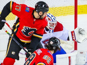 Calgary Flames left wing Andrew Mangiapane scores a goal against Montreal Canadiens goaltender Jake Allen at Scotiabank Saddledome.
