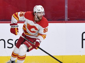 Apr 14, 2021; Montreal, Quebec, CAN; Calgary Flames defenseman Noah Hanifin (55) plays the puck during the second period of the game against the Montreal Canadiens at the Bell Centre. Mandatory Credit: Eric Bolte-USA TODAY Sports ORG XMIT: IMAGN-445579