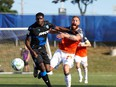 UPLOADED BY: Derek  Van Diest  ::: EMAIL: dvandiest@postmedia.com ::: PHONE: 780-868-6838 ::: CREDIT: Supplied / CPL ::: CAPTION: FC Edmonton defender Kareem Moses, left, fends off Forge FC midfielder Anthony Novak in Canadian Premier League Island Games play in Charlottetown, P.E.I., on Sunday, Aug. 16, 2020.