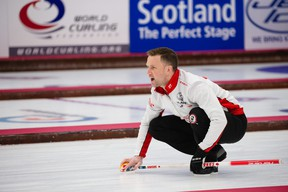 Team Canada's Brad Gushue throws a tock at curling's world mixed doubles tournament in Aberdeen, Scotland.