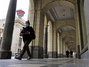 Pedestrians walk under the arches of the Hudson's Bay store in downtown Calgary on Thursday, May 13, 2021. Both the City of Calgary and the provincial government are looking at ways to revitalize the downtown core.