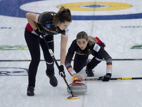 Germany skip Daniela Jentsch delivers a stone as only one teammate -- sister Analena Jentsch -- sweeps during their game against Canada at the world women's curling championship in Calgary on May 3, 2021. Germany, with only three players, defeated Canada 6-2.