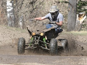 File photo: Gage Niven is seen riding his ATV as Albertans are out enjoying the May Long Weekend on their mud-kicking dirt bikes, ATV's and trucks at Mclean Creek Provincial Recreation Area Saturday, May 16, 2020.
