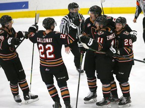 The Calgary Hitmen celebrate a goal during a game at the Seven Chiefs Sportsplex on Tsuut'ina Nation during a game in March. The Hitmen finished their abbreviated 2021 season with a 10-8-3 record.