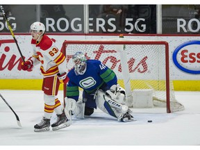 Calgary Flames forward Adam Ruzicka celebrates a goal scored on Vancouver Canucks goalie Braden Holtby by Josh Leivo at Rogers Arena in Vancouver on Sunday, May 16, 2021.