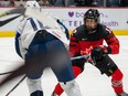 Team Canada's Meaghan Mikkelson, a proud mom of two, competes last winter in the Rivalry Series against the U.S. (Matthew Murnaghan photo, courtesy of Hockey Canada)
