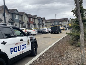 Police are seen in the area of 125 Street and 147 Avenue where a man was shot by Edmonton police early Saturday morning.