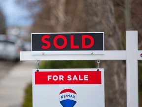 A home for sale and sold sign in Winston Heights was photographed on Tuesday, May 4, 2021.