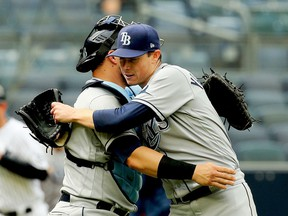 Jun 3, 2021; Bronx, New York, USA; Tampa Bay Rays starting pitcher Ryan Yarbrough (48) is congratulated by catcher Mike Zunino (10) after pitching a complete game against the New York Yankees at Yankee Stadium. Mandatory Credit: Andy Marlin-USA TODAY Sports ORG XMIT: IMAGN-432491