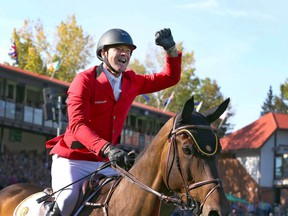 Belgium's Francois Jr Mathy celebrates on his mount Uno De La Roque after clinching the gold medal in the second round of the BMO Nations' Cup in the International Ring during The Masters show jumping event at Spruce Meadows in Calgary on Saturday, September 7, 2019. Jim Wells/Postmedia