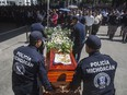 Relatives and members of the police department of Michoacan pay tribute to the officers killed in an ambush in Morelia, in the Mexican state of Michoacan, on October 15, 2019.