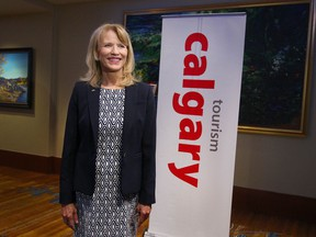 FILE - Cindy Ady Chief Executive Officer of Tourism Calgary speaks during a TV interview prior to the annual general meeting in Calgary on Wednesday May 24, 2017.