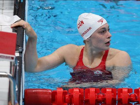 Penny Oleksiak of Team Canada reacts after competing in the first Semifinal of the Women's 100m Freestyle, July 29, 2021 in Tokyo, Japan.