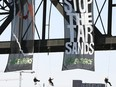 Greenpeace protesters hang from the High Level Bridge in Edmonton on Nov. 7, 2007, in a protest against the Alberta oilsands.