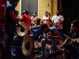 A band plays for the crowd on Bourbon Street as Louisiana's COVID-19 cases rise amid Delta variant, in New Orleans, La., July 23, 2021.