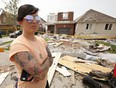 A tornado tore through a neighbourhood in the southeast end of Barrie on Thursday damaging at least 150 homes. Natalie Harris is seen here outside her ex-husband's home on Majesty Blvd., where she managed to hide in the home's basement with her son and two dogs just before the tornado hit, on Friday July 16, 2021.