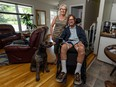 Ken Elliott, his wife Linda Brooks and their dog Roxy in their renovated Lake Bonavista home. Elliott was paralyzed after being shot during a home invasion while on vacation in Barbados.