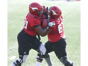 Calgary Stampeders offensive lineman battle it out during the CFL team's training camp in Calgary on Saturday, July 10, 2021. Jim Wells/Postmedia