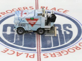 A zamboni driver wearing a face mask floods the ice during the first day of the Edmonton Oilers training camp for the 2019-20 NHL return to play venture at Rogers Place on Monday, July 13, 2020.