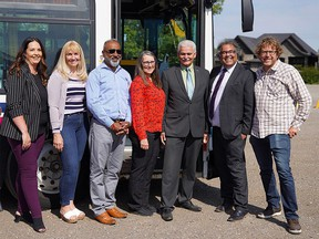 Calgary Mayor Naheed Nenshi (second from right) and Chestermere Mayor Marshall Chalmers (third from right) pose for a photo with Calgary and Chestermere council members after announcing a new transit link between the two municipalities. Monday, August 30, 2021.
