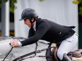 Ireland's Jordan Coyle rides Ariso at the first round of the TC Energy Cup in the International Ring at Spruce Meadows on Wednesday.