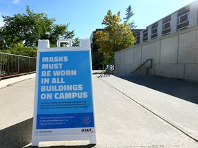Signs around the SAIT campus in Calgary reminding visitors, staff, students to wear masks are shown on Thursday, September 16, 2021.