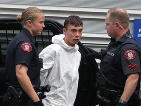 Brandon Newman, the suspect in the fatal stabbing of 47-year-old Deborah Onwu is taken to the arrest processing unit on Friday, October 25, 2019. Newman pleaded guilty to second-degree murder in the case.