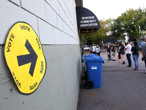 Advance polls at the Renfrew Community Association were around the block in Calgary on Monday, September 13, 2021.