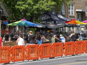 Patios along 17 Ave. in Calgary were busy as businesses reopened on Tuesday, June 1, 2021.