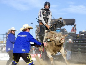 Jared Parsonage rides Spare Parts during the opening night of the Cody Snyder Charity Bullbustin' event at the Grey Eagle Resort and Casino in Calgary on Tuesday, Sept. 7, 2021.