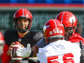 Calgary Stampeders quarterback Jake Maier looks to throw the ball during practice in Calgary on Saturday.