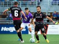 Cavalry FC (in black) battles Pacific FC in Canadian Premier League action at Starlight Stadium in Langford, B.C., on Thursday, Sept. 9, 2021.
