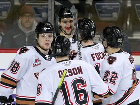 The Calgary Hitmen celebrate a goal  against the Regina Pats at the Saddledome in this photo from Feb. 12, 2020.